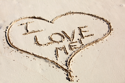 I Love Me Written inside a Heart Drawn in Sand